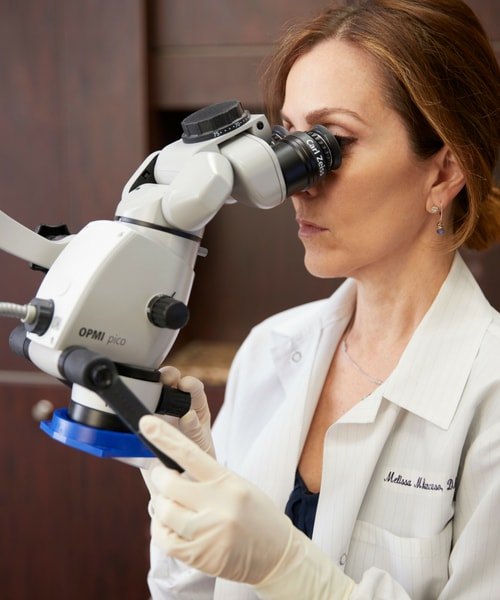 Dr. Mancuso performing microscope enhanced dentistry in Woburn