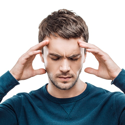 Man experiencing headaches because of TMJ pain
