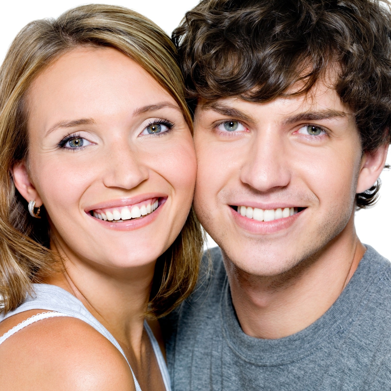 Young couple happily smiling about the results of their smile design.