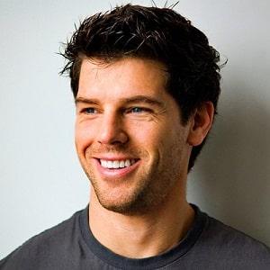 Smiling man with beautiful teeth due to dental bonding.