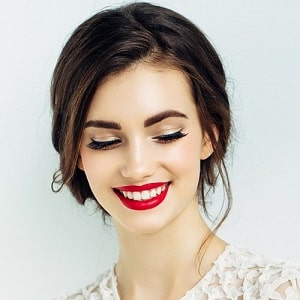 Pretty man with bright red lipstick and a beautiful smile.