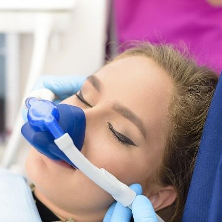 A woman undergoing sedation dentistry