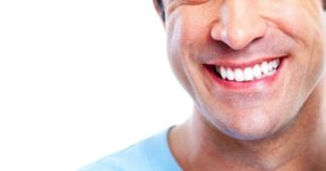Man smiling with long-lasting cerec crowns